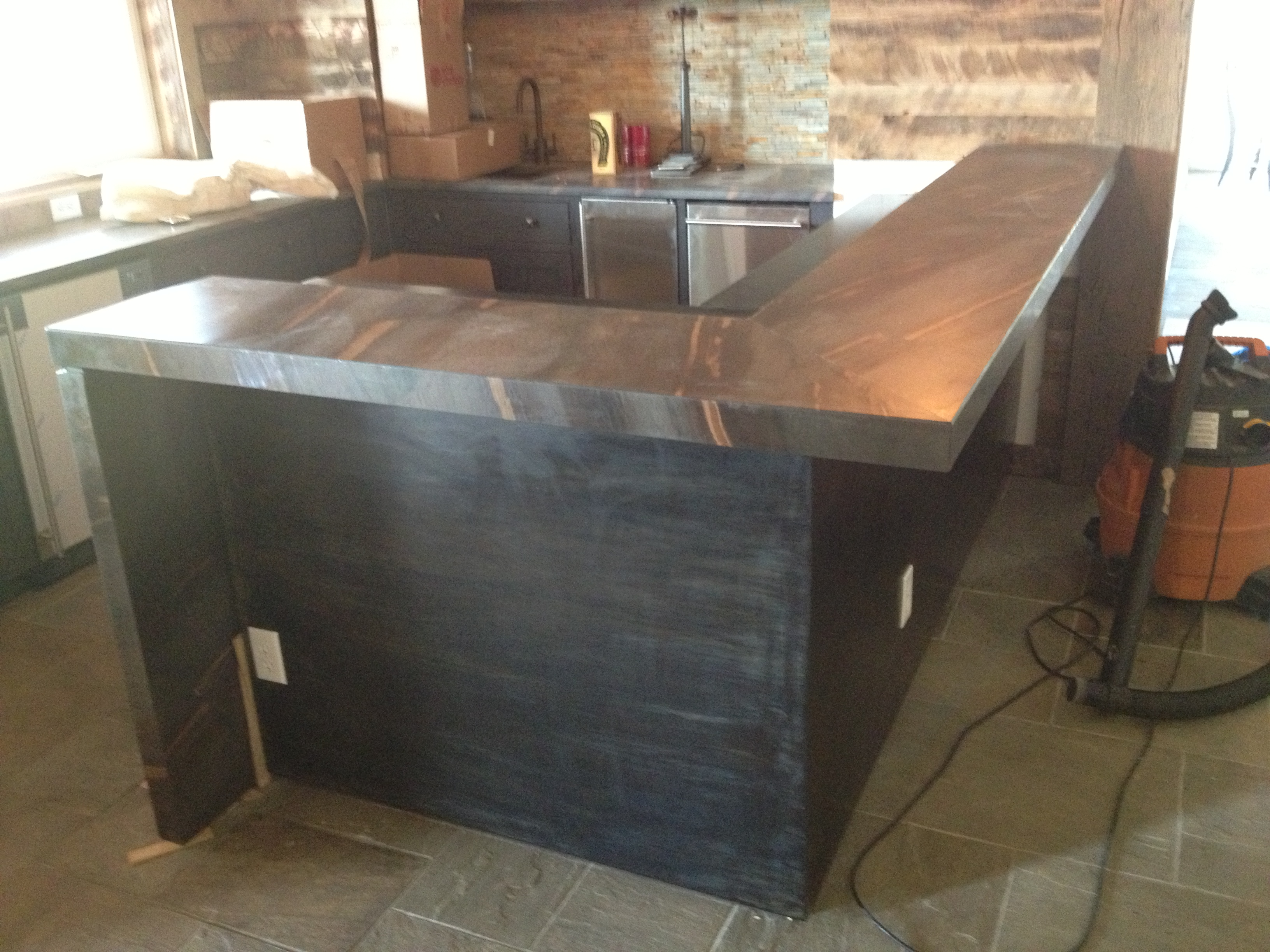 mottled steel bar wrap and counter top we have been working on.